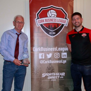 Joe Murphy collects his CBL Distinguished Service Award for his outstanding contribution to Cork County Council FC and as the League's Registrar. Peter Travers (CBL Secretary) also pictured.
