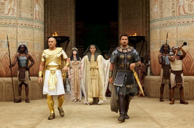 DF-00727R - Seti (John Turturro, background) presents the future leaders of Egypt: Ramses (Joel Edgerton, left) and Moses (Christian Bale).