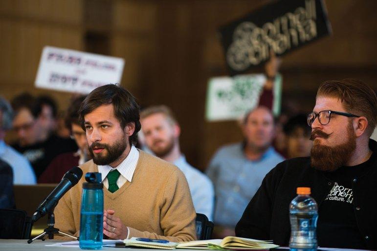 Cornell Cinema advocates Douglas McLaren '05 (left) and Elijah Weber-Han '16 (right) speak at the Student Assembly Meeting Thursday. (Cameron Pollack / Sun Senior Photographer)