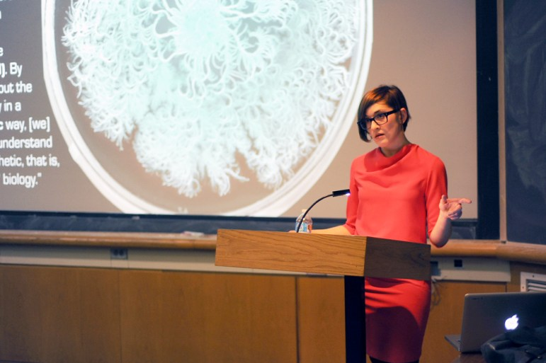 Prof. Sophia Roosth, history of science, Harvard University, speaks about the way we understand and define life in Kaufmmann Auditorium Thursday. (BrittneyChew / Sun News Photography Editor)