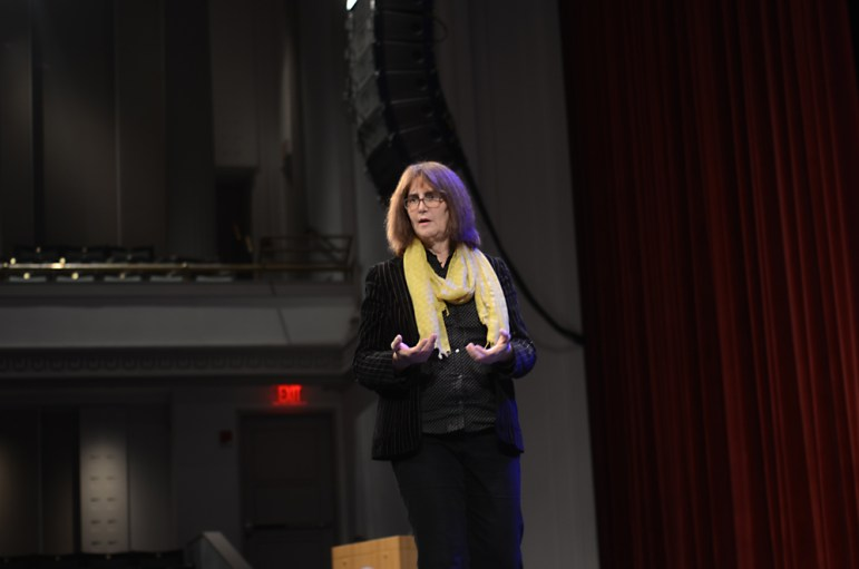 A speaker addresses the issues facing the LGBT community at the IvyQ conference in Bailey Hall this weekend. (Jade Song / Sun Staff Photographer)