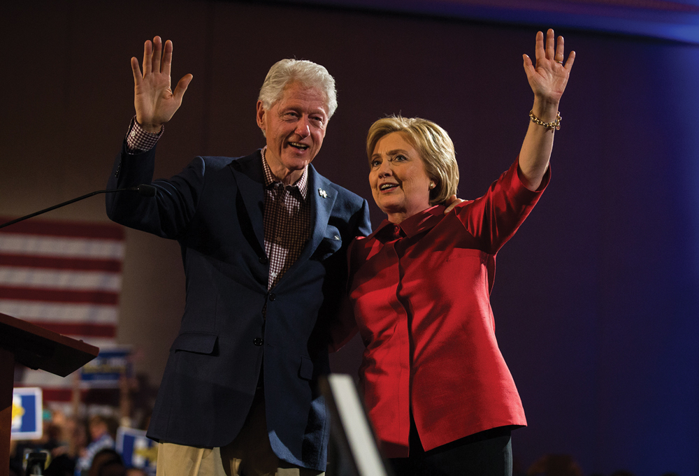 Bill and Hillary Clinton wave to supporters in Las Vegas on Saturday