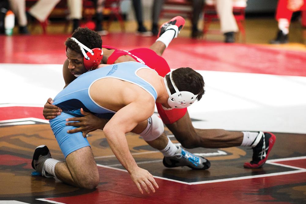 Nahshon Garrett won both his matches as Cornell surged past Penn and Princeton.