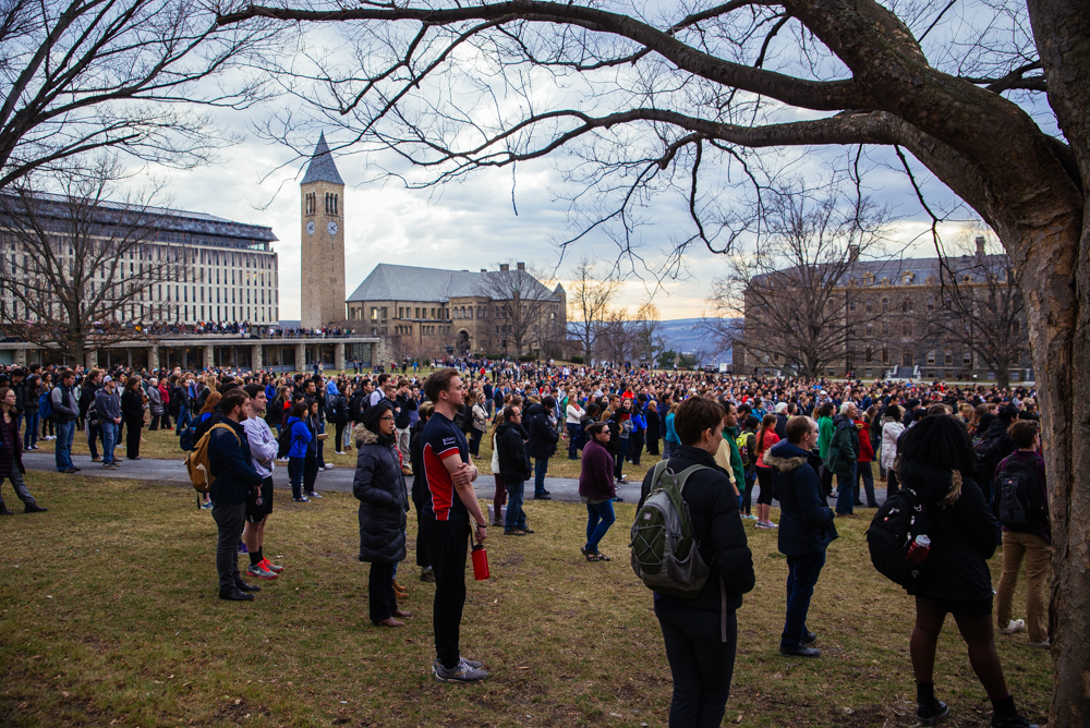 Cornellians gather on the Arts Quad  to honor President Elizabeth Garrett with a moment of silence.