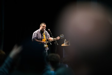 """Joe Driscoll performs """"Water,"""" a song about the perils of tracking before Bernie Sanders takes the stage."""