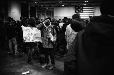 """Young people carry """"Students for Bernie"""" posters in Oncenter."""