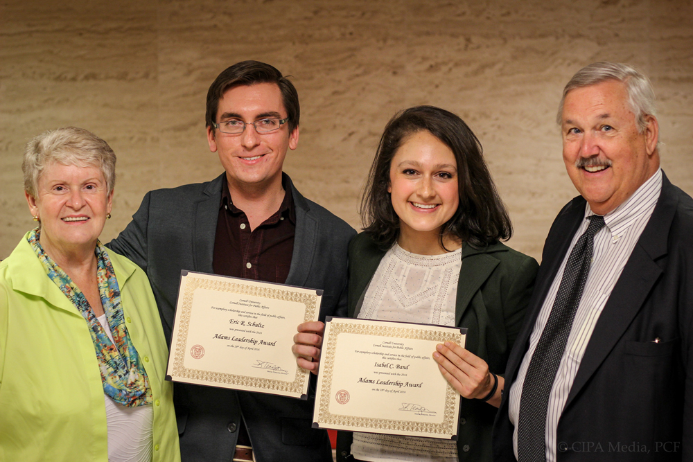 Eric Schultz grad and Isabel Band grad, two students pursuing a masters in Public Administration, receive the Adams Leadership award at a ceremony Thursday.