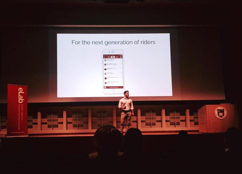 Brian Schiff '18, one of RedRoute's founders, presents the app at eLab's Demo Day April 14.