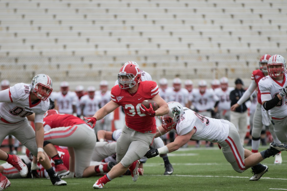 Junior Jack Gellatly runs through Brown's defense in last year's 44-24 loss against the Bears.