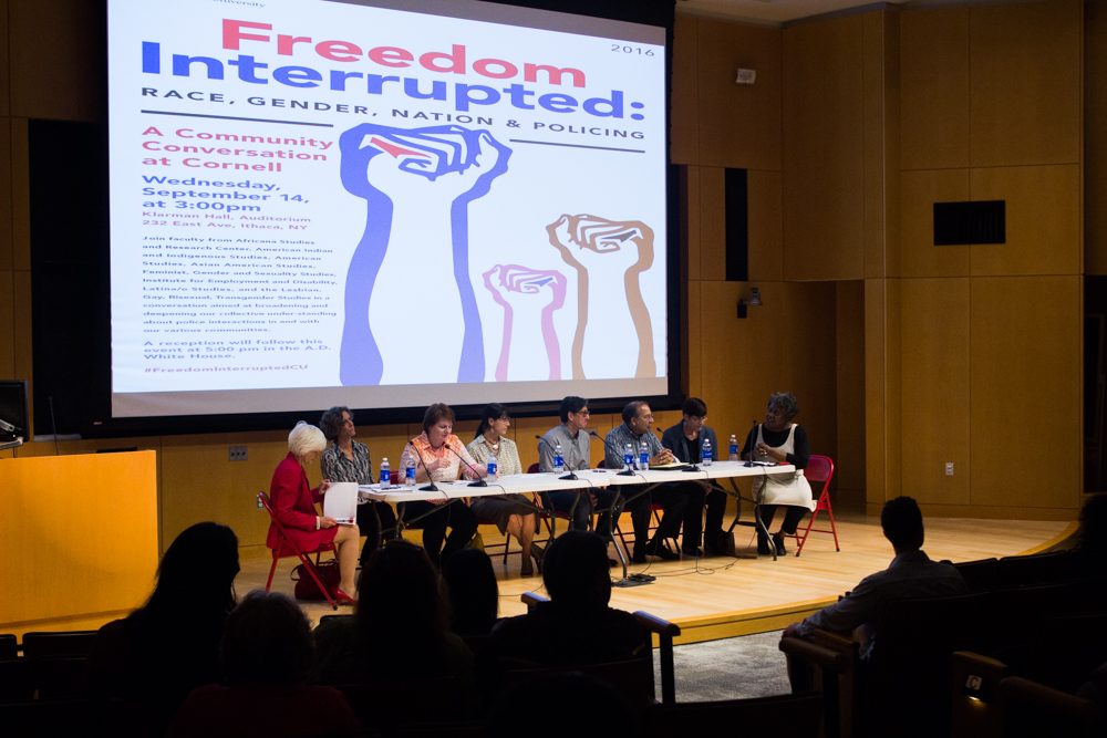 """Cornell faculty speak at a """"Freedom Interrupted"""" lecture in Klarman Atrium on Wednesday."""