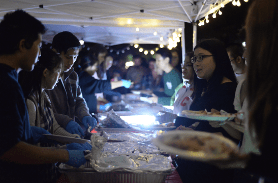 Students line up to try Asian foods in stalls on Ho Plaza Friday night.