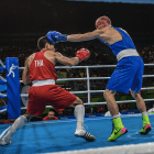 Chatchai Butdee of Thailand and Vladimir Nikitin of Russia fight in a preliminary round mens boxing match, at the 2016 Summer Olympic Games in Rio de Janeiro.