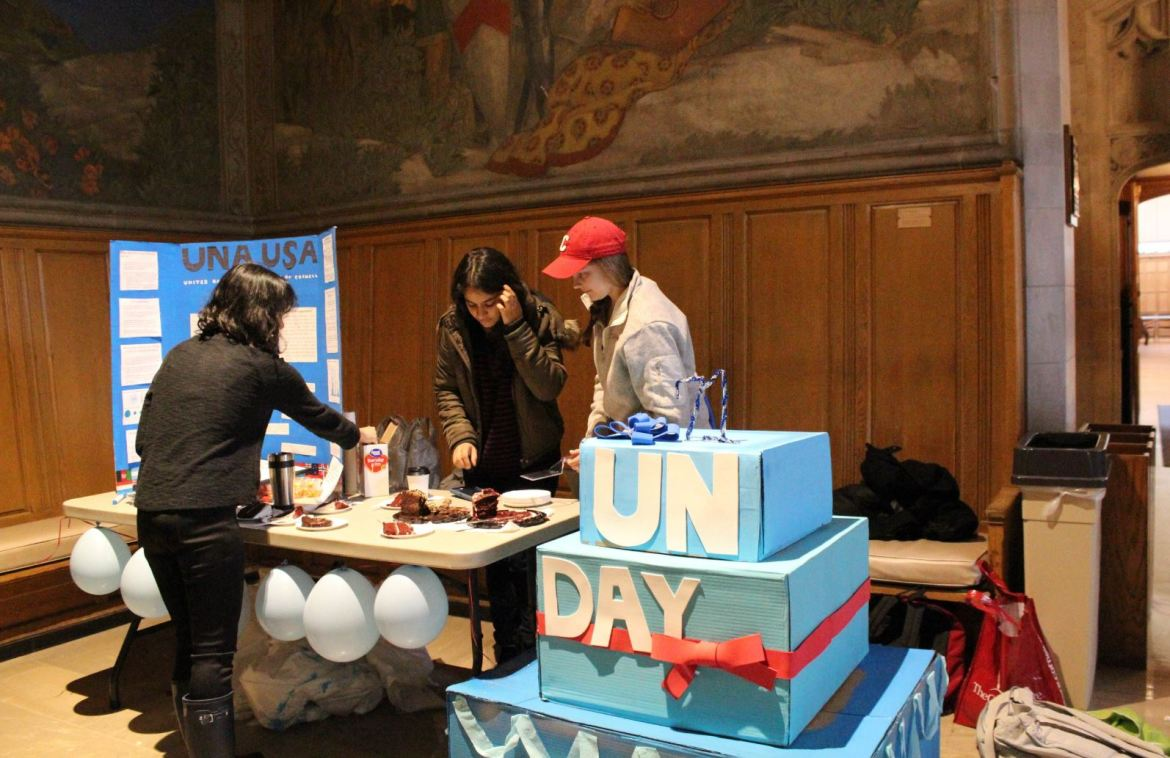 Students cut cake and discuss the refugee crisis in Willard Straight Hall Monday, celebrating the 71st birthday of the United Nations.