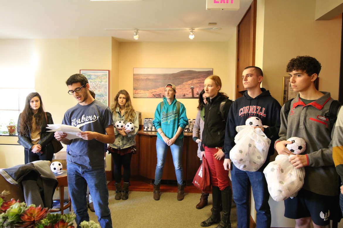 Members of COLA placing soccer balls and delivering a letter to the president's office. Matthew DiSegano '20 reading the letter in Day Hall on Thursday, November 10.