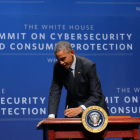 President Barack Obama signs an executive order promoting the sharing of cybersecurity information in the private sector and with the government, at a summit in Palo Alto, Calif., Feb. 13, 2015.