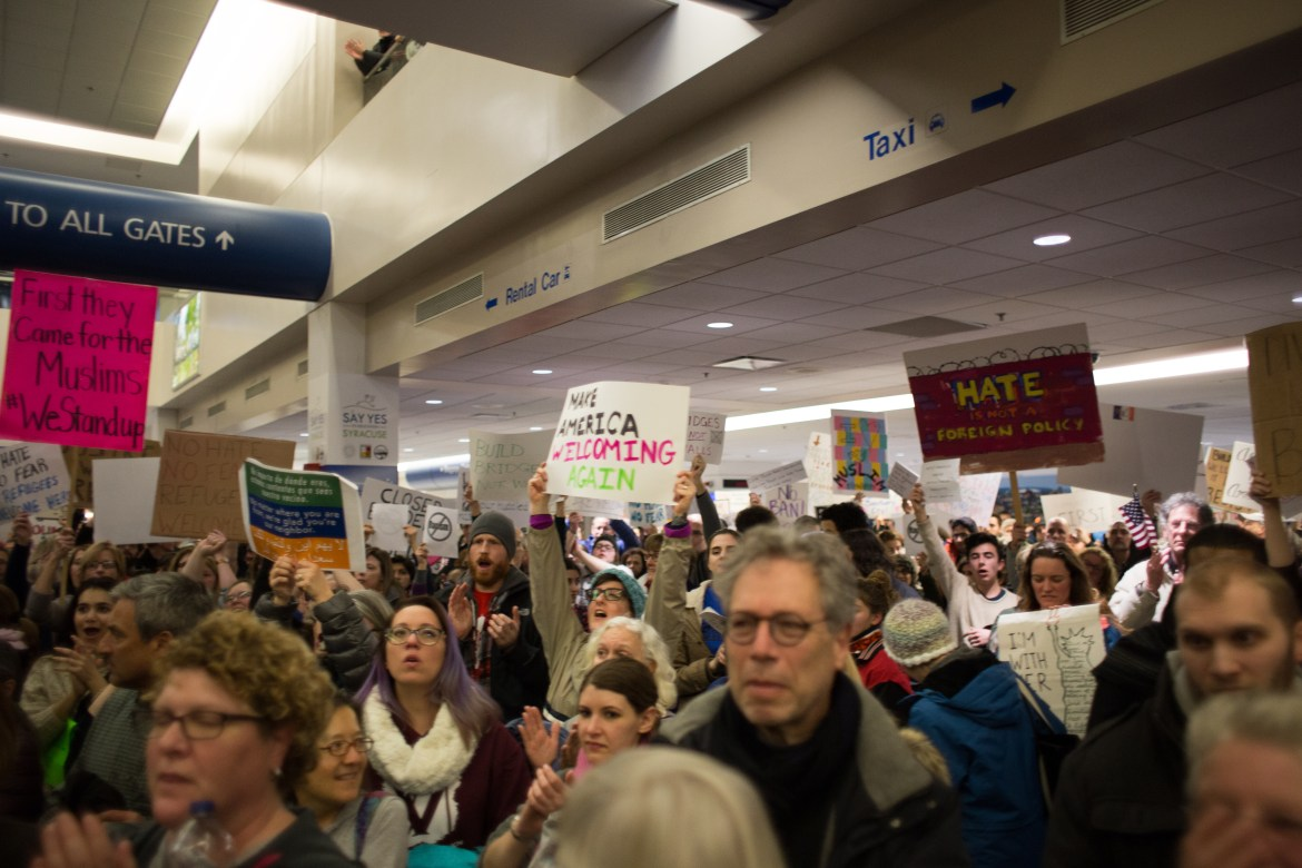 Hundreds protest against Donald Trump's executive order banning refugees at Syracuse Hancock International Airport Sunday.