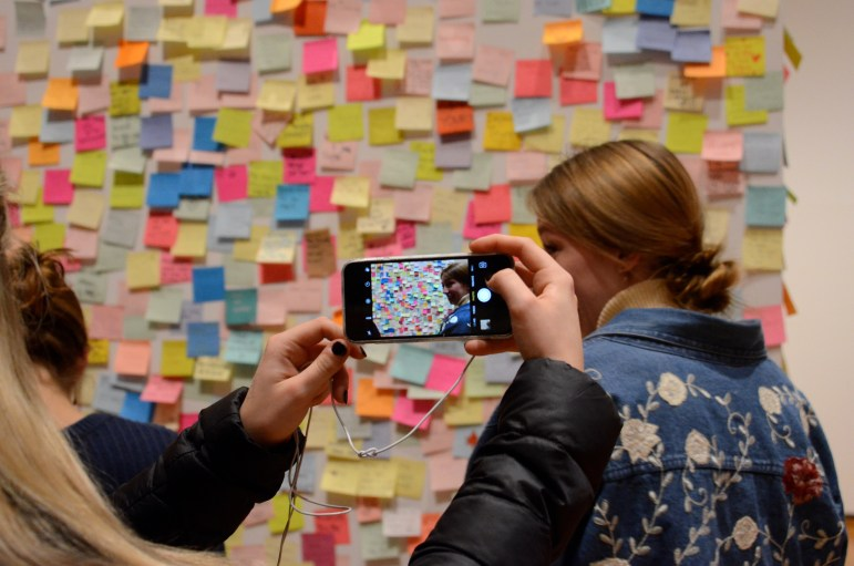 A Cornell student snaps a picture of the exhibit at the Johnson on Thursday.