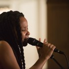 Jamila Woods performs in Risley Dining on Saturday night. (Cameron Pollack / Sun Photography Editor)