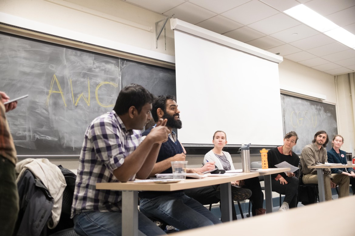 Cornell Graduate Student Union and At What Cost representatives present their platforms and address graduate students' concerns surrounding unionization at a question and answer session held in Olin Hall Thursday.
