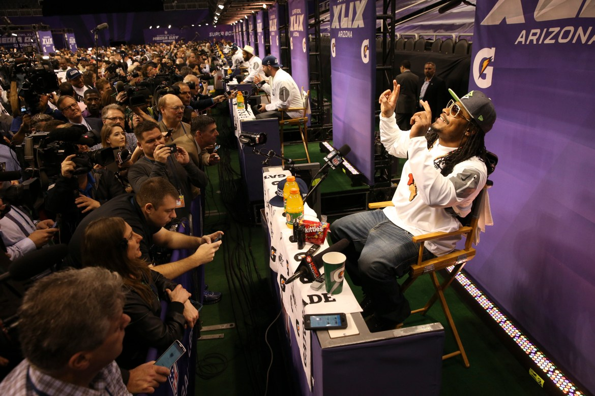 Seattle Seahawks running back Marshawn Lynch speaks to reporters during Super Bowl XLIX Media Day at the U.S. Airways Center in Phoenix.