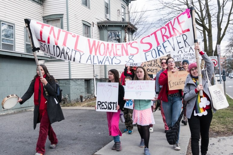 Nearly 200 people marched along a 1-mile route in Ithaca on Wednesday for International Women's Day.