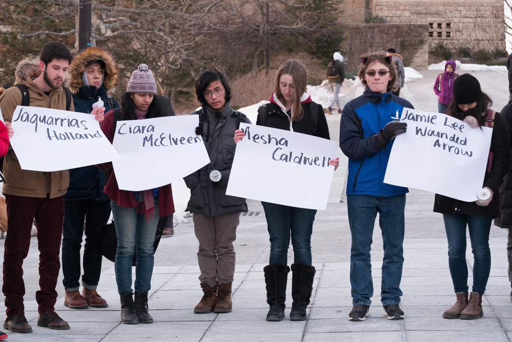 Students open a dialogue around the lives of transgender women in a vigil on Ho plaza on Wednesday.