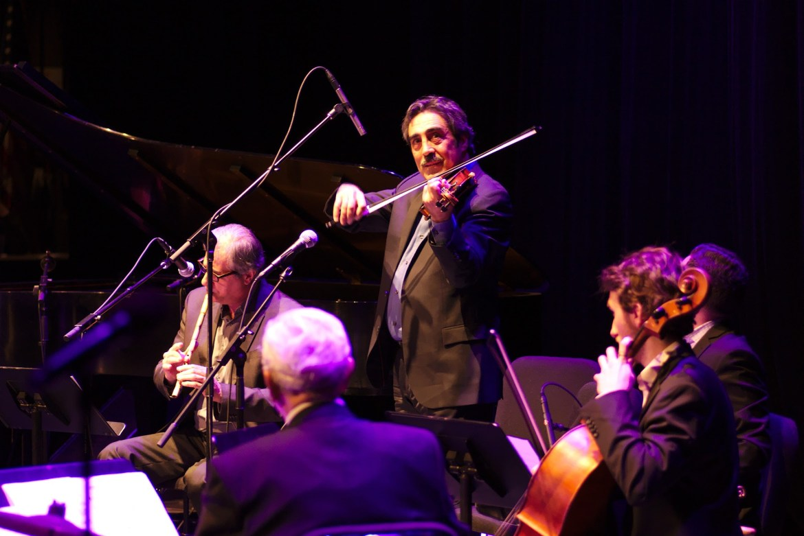 Simon Shaheen plays violin during his performance of Zafir at Bailey Hall.
