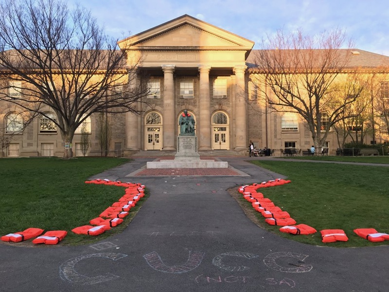 Life jackets line the Arts Quad bearing testimonials from refugees who have crossed the Mediterranean Sea as part of the Week of Action for Refugees