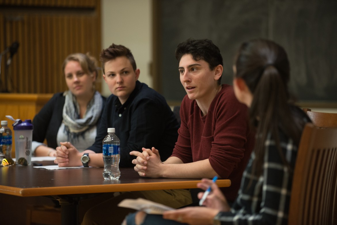 "Aiden Cropsey from the LGBT Resource Center, Jesse Bonney-Burrill from the Skorton Center for Health Initiatives and Dylan Jacobs '17 speak as part of a panel called ""Mythbusting: Impacts of Gender"" in Goldwin Smith Hall on Friday."