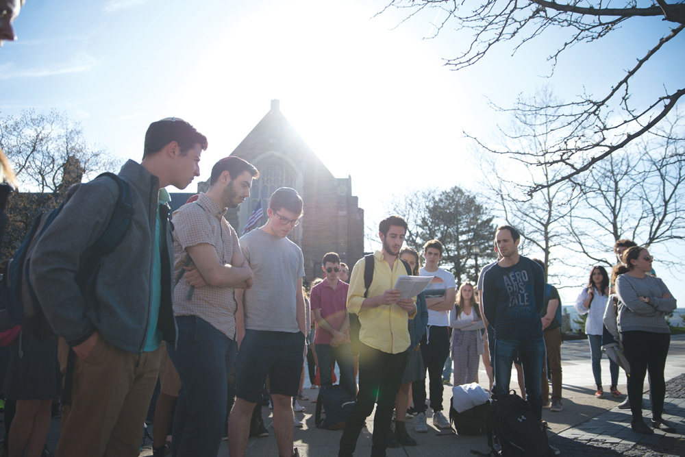 Cornellians gather on Ho Plaza and share stories and poems in honor of the millions of individuals who perished in the Holocaust.