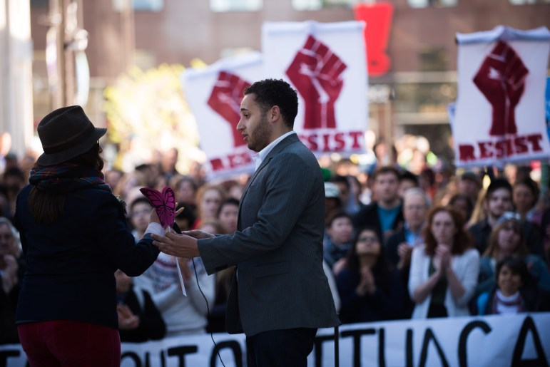 Ithaca Mayor Svante Myrick '09 stands beside Carolina Osorio Gil, director of ¡Cultura! Ithaca at Wednesday's protest of an ICE arrest. Myrick said city officials expressed their displeasure with the arrest directly to an ICE field director.