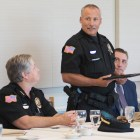 Cornell Police Officer Ronald Rogers, center, was honored Monday by a local group and by the department's chief, Kathy Zoner, left.