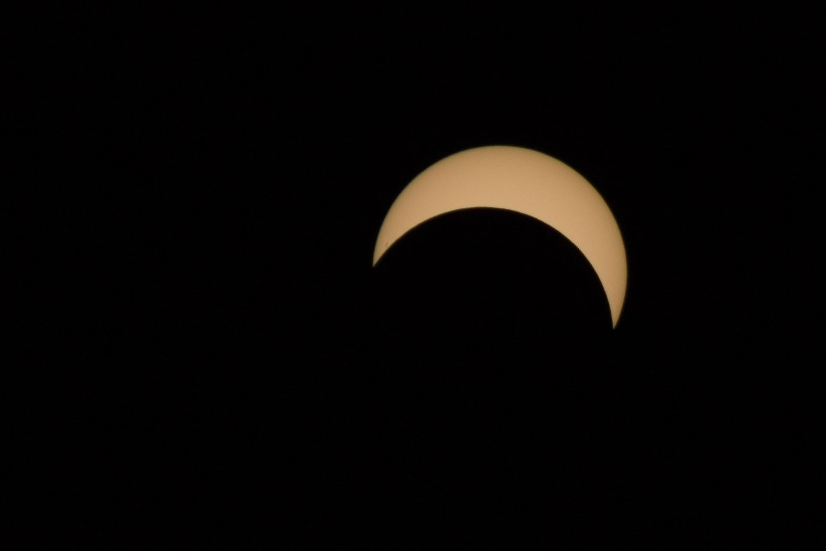The moon passed between the Earth and the sun on Monday as thousands of Cornellians looked on from around campus.