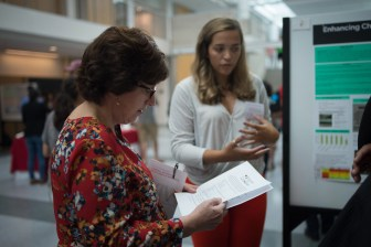 Martha Pollack speaks to Elizabeth Cavic '18 in the Physical Sciences Building, August 24th, 2017.