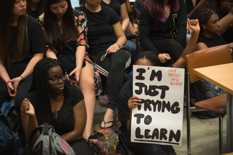 Members of Black Students United and supporters protest at a University Assembly meeting in Clark Hall, Sept. 19, 2017.