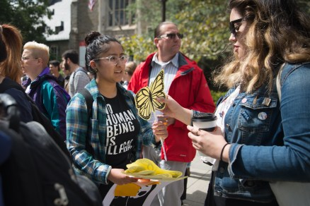 Mayra Valadez '18 hands out butterfly signage at the Cornell DREAM Team's protest against the recision of the Deferred Action for Childhood Arrivals program earlier this week, September 8th, 2017.