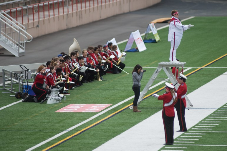 Members of the Big Red Marching Band take a knee during the national anthem before football's game against Colgate Saturday.
