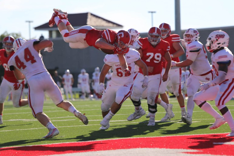 J.D. PicKell soars for a touchdown against Yale in a Homecoming win for Cornell last year.