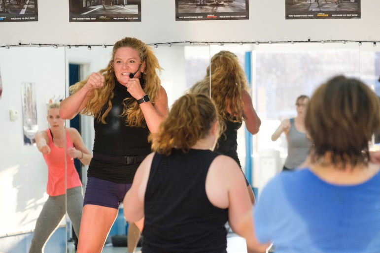 Jessica Kerns teaches a bodycombat class at FLX Fitclub, a fitness club founded by alumna Chantelle Farmer '91.