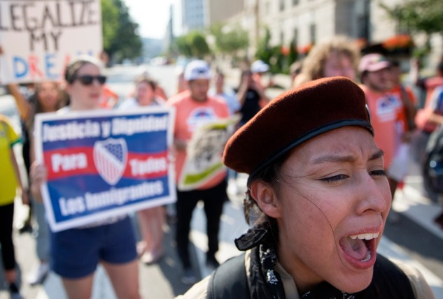 Demonstrators march from Lafayette Park towards the White House to protest the decision to end the Deferred Action for Childhood Arrivals program in Washington, Sept. 5, 2017. (Tom Brenner/The New York Times)