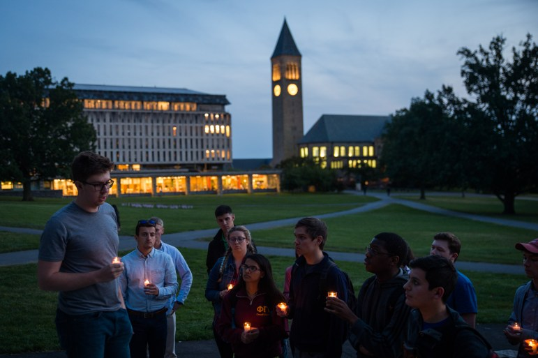 Austin McLaughlin '18, President of the Cornell Republicans (left), speaks at a candlelight vigil hosted by the Cornell Republicans on the Arts Quad on September 11th, 2017. (Cameron Pollack / Sun Photography Editor)