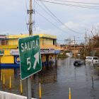 Flood waters surround a yellow building in Puerto Rico after the hurricane.