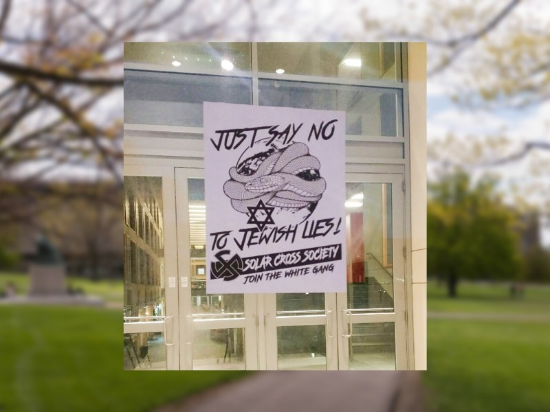 A poster advertising a hate group that seems to be in its infancy or non-existent on the door to Duffield Hall.