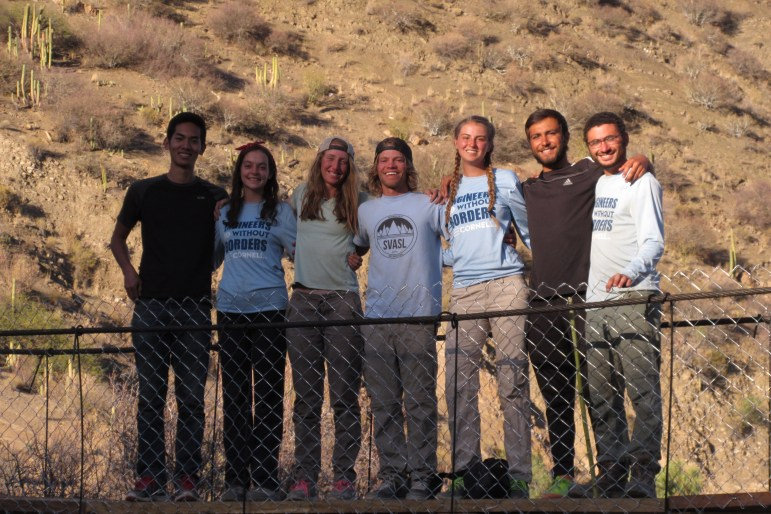Members of Cornell Engineering Without Borders on the completed bridge in 2016.