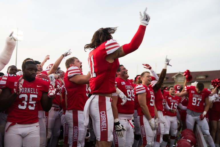 Senior captain and safety Nick Gesualdi leads the team celebration after the Homecoming win over Brown.
