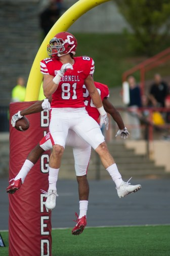 Sophomore wide receiver Davy Lizana (81) and sophomore running back Harold Coles celebrate Coles' second touchdown on the day.