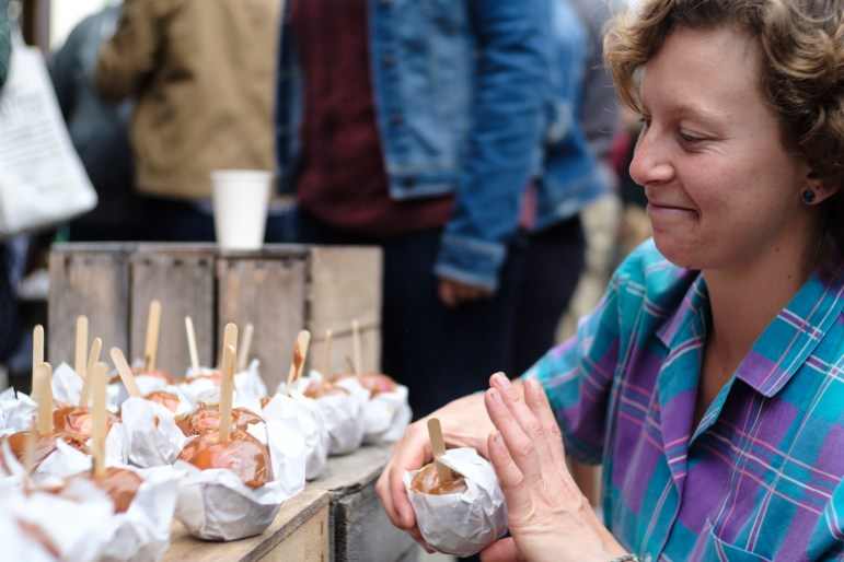 Stalls selling caramel apples, apple cider donuts and apple crisps are the most popular at Apple Harvest Festival on Sept.30, 2017. (Michael Suguitan/Sun Staff Photographer)