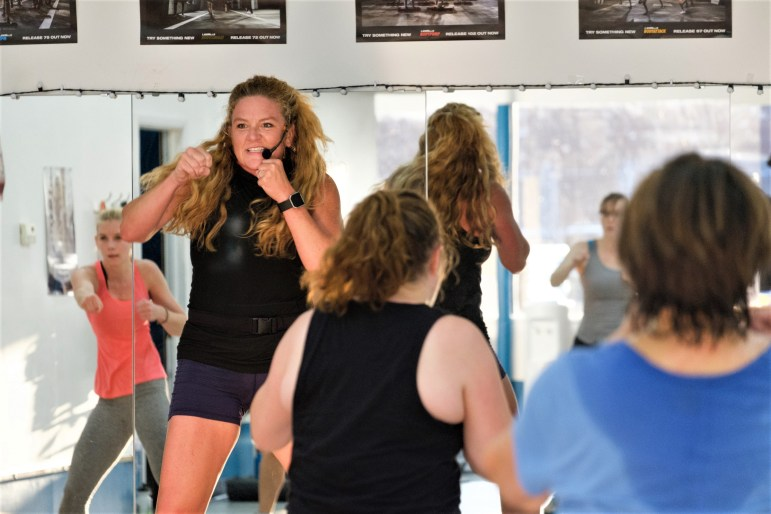 Jessica Kerns teaches a body combat class at FLX Fitclub, a fitness club founded by alumna Chantelle Farmer '91, on Tuesday, 26 Sep. (Michael Suguitan / Sun Staff Photographer).