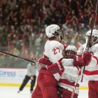Alec McCrea celebrates his game-winning goal in the final seconds with his teammates. McCrea, once a Harvard commit, lifted Cornell to its first win over the Crimson since 2015.