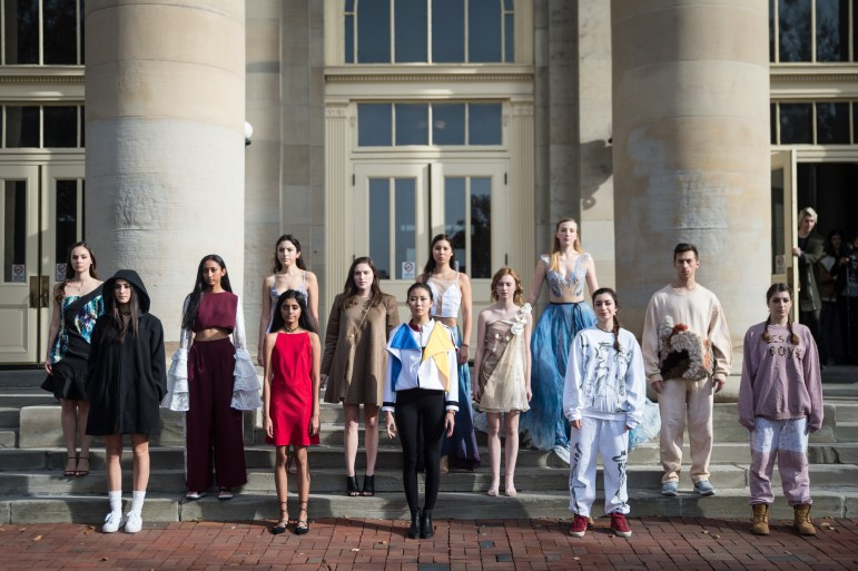 The Cornell Fashion Collective's flash fashion show, featuring work from student designers' collections from the 2017 runway show, makes its way around campus on Nov. 15, 2017.